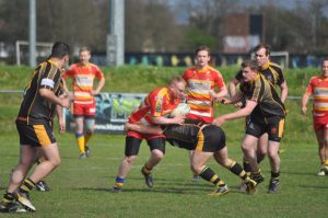 Mancunians RL's Stuart Stones drives the ball in.