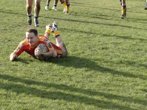 Fisher scoring Mancunians final try in the Manchester Rugby League derby.